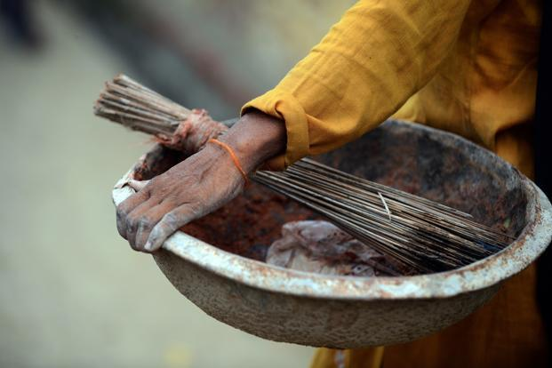 Activists say the sanitation campaign or Swachh Bharat Abhiyan, has failed to end the practice of manual scavenging in India. Photo: AFP