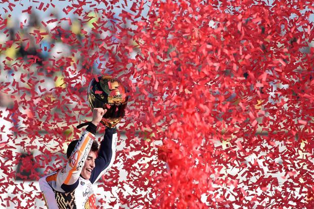 Repsol Honda Team's Marc Marquez celebrates after the MotoGP race of the Valencia Grand Prix at Ricardo Tormo racetrack in Cheste, near Valencia on Sunday. Photo: AFP