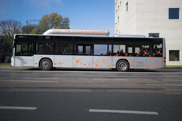 A MAN SE compressed natural gas (CNG) fueled bus sits parked on a street during the Volkswagen AG (VW) CNG Mobility Day in Essen, Germany, on 7 November. Photo: Bloomberg