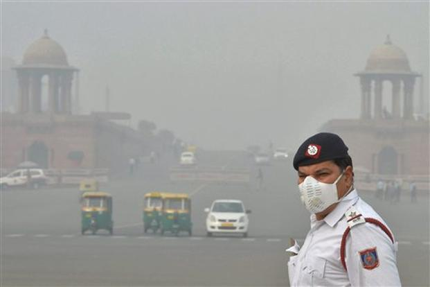 The mass distribution of masks and air purifiers would impose too high a cost in comparison to the relatively trivial reduction of harm that results. Photo: PTI