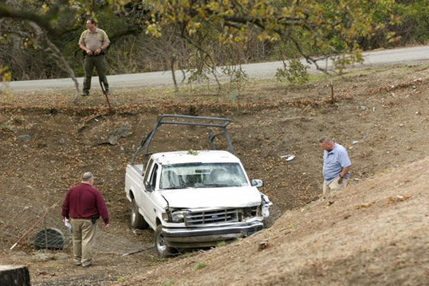 Investigators view a pickup truck involved in a deadly shooting rampage at the Rancho Tehama Reserve in California on Tuesday. Photo: AP