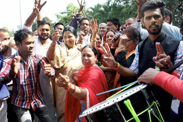 Congress workers celebrate Nilanshu Chatruvedi's win in the Chitrakoot bypoll, in Bhopal on Sunday. Photo: PTI