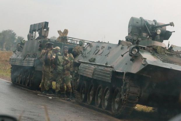 Denying that the action was a coup, Major General Sibusiso Moyo said 'as soon as we have accomplished our mission we expect the situation to return to normalcy'. Photo: Reuters