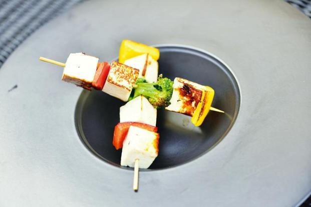 Paneer satay with peppers and broccoli.
