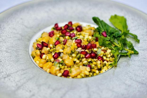 Sprouts-chickpeas salad with pomegranate.