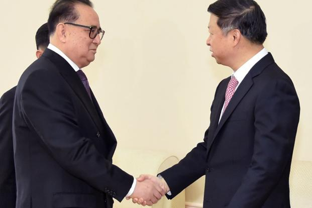 Song Tao (right) the head of China's ruling Communist Party's International Liaison Department, shakes hands with Ri Su Yong, vice chairman of North Korea's ruling party, in Pyongyang on 18 November 2017. Photo: AP/Kyodo News