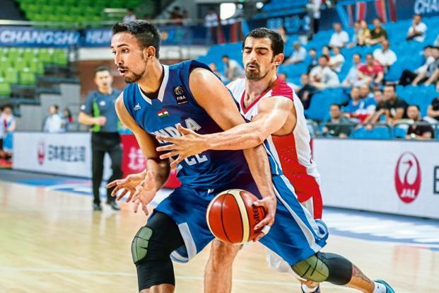Amjyot Singh Gill (in blue) in a match against Iran in the 2015 FIBA Asia Championships in China. Photo: AFP