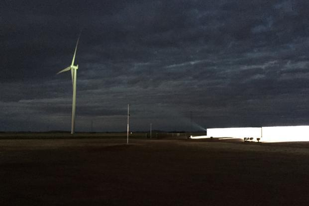 Tesla power packs have now been fully installed on a site near a wind farm north of Adelaide and will be tested to ensure the battery meets standards laid down by the energy market operator. Photo: Reuters