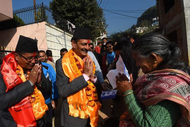 Nepali Congress and Democratic alliance election candidate Nabindra Raj Joshi (C)gesturing as he takes part in a door-to-door in election campaign in Kathmandu. Nepal is holding provincial and parliamentary elections in two phases on 26 November and 7 December. Photo: AFP