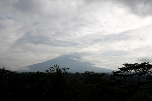File photo of Mount Agung. Mount Agung spewed smoke as high as 4,000 metres (13,123 feet) above its summit Sunday morning. Photo: Reuters