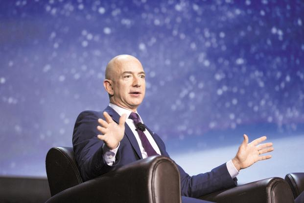 Amazon boss Jeff Bezos makes record $100bn
