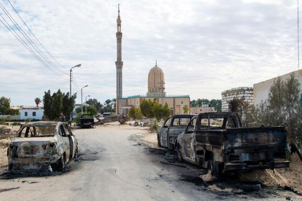 Carrying the black flag of Islamic State, the assailants arrived in off-road vehicles before opening fire on Al Rawdah mosque in North Sinai, leaving its carpets stained with blood. Photo: AFP
