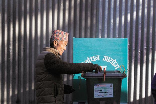 A Nepalese man casts his vote in Chautara, during the first phase of Nepal elections  on Sunday. The second phase will be held on 7 December and results are expected later next month. Photo: AP