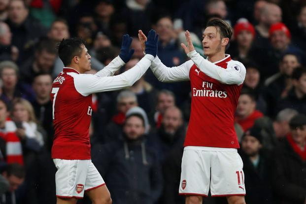 Mesut Ozil has been linked with a move to Barcelona while Alexis Sanchez almost joined Manchester City on the final day of the summer transfer window. Photo: Reuters