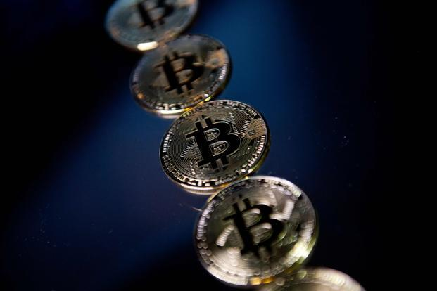 Bitcoin prices fell as much as 8% on Thursday on Bitstamp online exchange to hit $9,000 exactly, marking a fall of well over $2,000 in under 24 hours. Photo: AFP