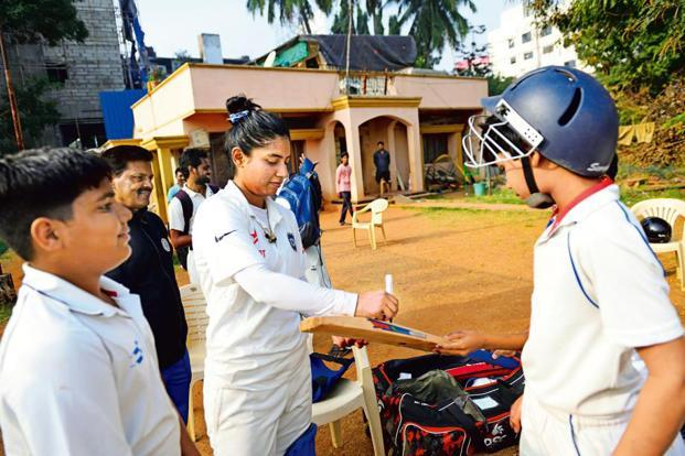 Mithali Raj autographing bats for students at St John's Cricket Academy in Secunderabad.