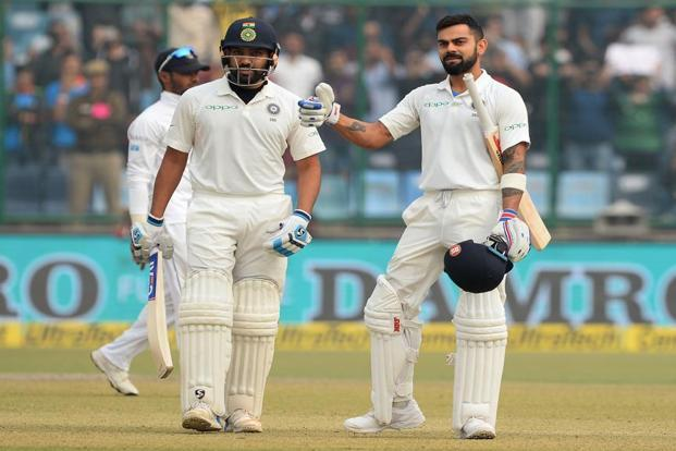 Virat Kohli (R) celebrates after completes his double century (200 runs) as and Rohit Sharma looks on during the second day of the third Test cricket match between India and Sri Lanka at the Feroz Shah Kotla Cricket Stadium in New Delhi. Photo: AFP