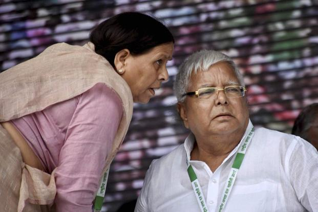 A file photo of RJD chief Lalu Prasad, his wife Rabri Devi. In July, ED had registered a case against Lalu, his family members and others under various provisions of the money laundering act. Photo: PTI