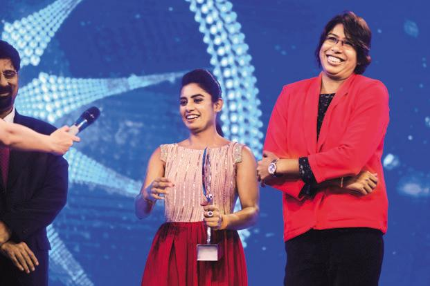 Indian women's cricket team captain Mithali Raj (left) and all-rounder Jhulan Goswami receive the special achievement award on behalf of the team. Photo: Pradeep Gaur/Mint