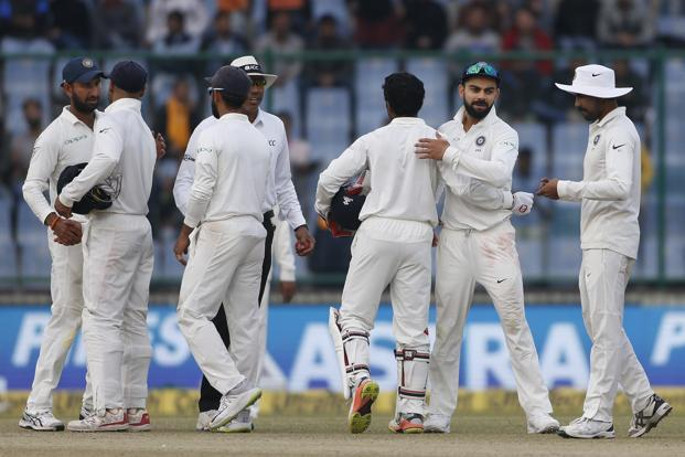 India's captain Virat Kohli hugs his teammates at the end of third test cricket match against Sri Lanka in New Delhi on 6 December 2017. Photo: AP