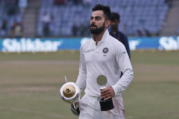India's captain Virat Kohli holds the trophy at the end of third test cricket match against Sri Lanka in New Delhi on 6 December 2017. Photo: AP