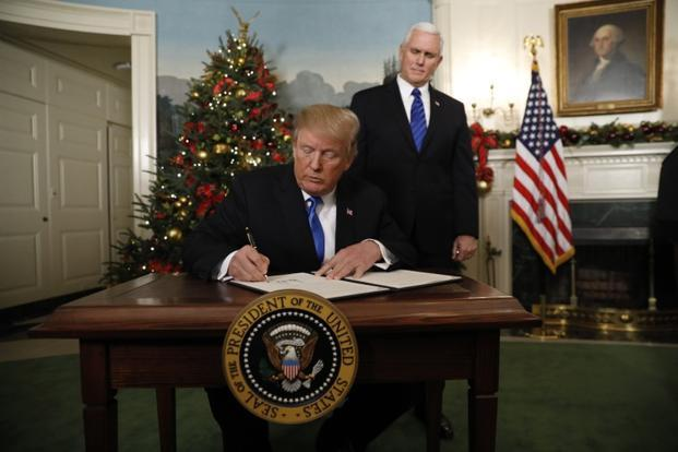 President Donald Trump signs an executive order after he announced the US would declare Jerusalem as the capital of Israel, in the Diplomatic Reception Room of the White House in Washington on Wednesday. Photo: Reuters