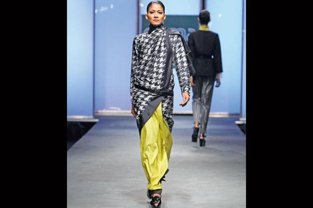 """At the time (2011), I was interested in exploring menswear through an Indian woman's perspective,"" says Abraham. The collection looked at European menswear weaves like the houndstooth, twill, herringbone and re-invented them with Indian textile traditions like Ikat and block printing. The sari became a part of the Victoria & Albert Museum's collection"