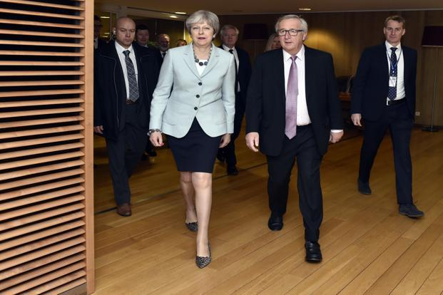 Britain's prime minister Theresa May, walks with European Commission president Jean-Claude Juncker prior to a meeting at EU headquarters in Brussels on Friday. Photo: AP