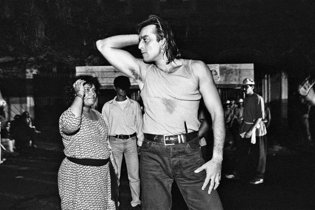 Saroj Khan teaching moves to Sanjay Dutt for 'Tamma Tamma Loge' in 'Thanedaar' (1990). Unprecedented for Hindi cinema, the song was over six-and-a-half-minutes long and had intricate Michael Jackson-style moves.