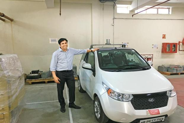 Ritukar Vijay, head of autonomous technologies and business strategy at the firm, beside a fully-autonomous Mahindra Reva. Photo: Sunny Sen/FactorDaily