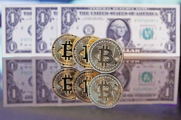 The CBOE started bitcoin futures trading on Monday, and their value shot up despite bitcoin price remaining relatively lower. Photo: Bloomberg