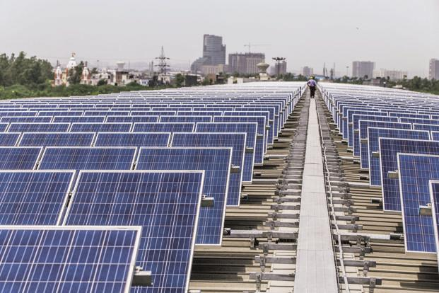 India witnessed a record low solar tariffs of Rs2.44 per unit in May, which rose up to Rs2.65per kWh in an auction conducted by the Gujarat government in September. Photo: Bloomberg
