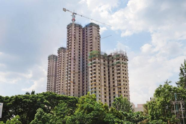 Under GST, while under-construction houses attract 12% tax, the quantum of tax rebates available to real estate firms on the final product is substantial as the tax already paid on raw materials is substantial at 18%. Photo: Hemant Mishra/Mint
