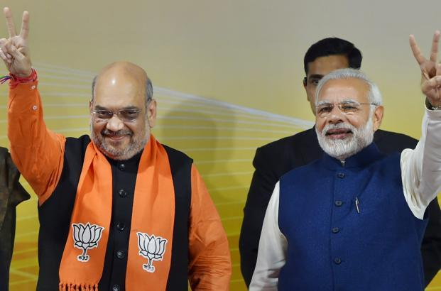 PM Narendra Modi (right) and BJP president Amit Shah at a felicitation function before the party's parliamentary board meeting in New Delhi on Monday, after the party's win in Gujarat and Himachal Pradesh assembly elections. Photo: PTI