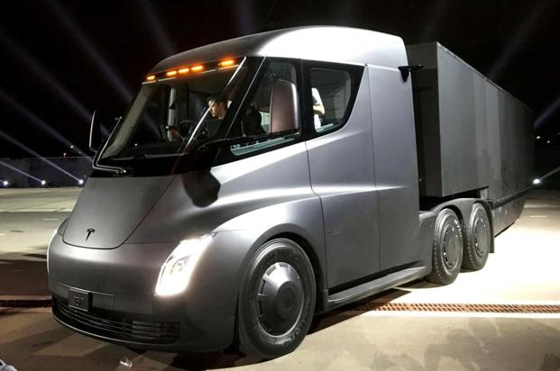 Tesla is trying to convince the trucking community it can build an affordable electric semi-trucks to compete with relatively low-cost, time-tested diesel trucks. Photo: Reuters