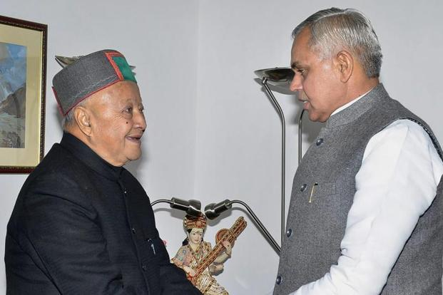 Shimla: Outgoing Chief Minister Virbhadra Singh meets Governor Acharya Devvrat to submits his resignation, at Raj Bhawan in Shimla on Tuesday. PTI Photo (PTI12_19_2017_000107A)