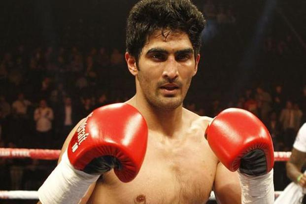 File photo. Vijender Singh listens to calm music before a bout. Photo: Reuters