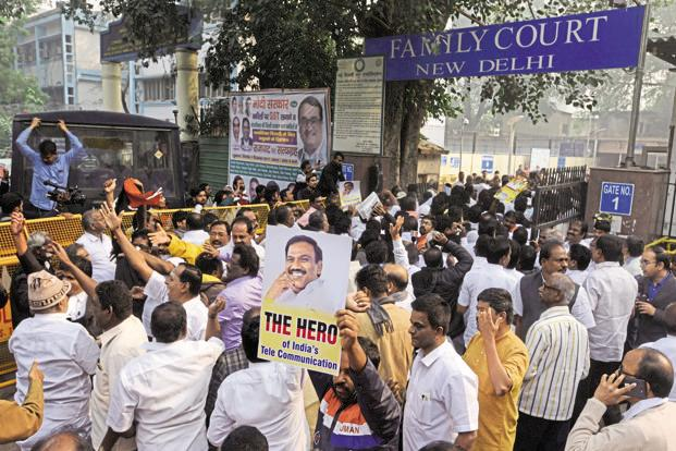 Supporters of ex-telecom minister A. Raja celebrate the 2G scam verdict outside Patiala house court in New Delhi on Thursday. Photo: HT