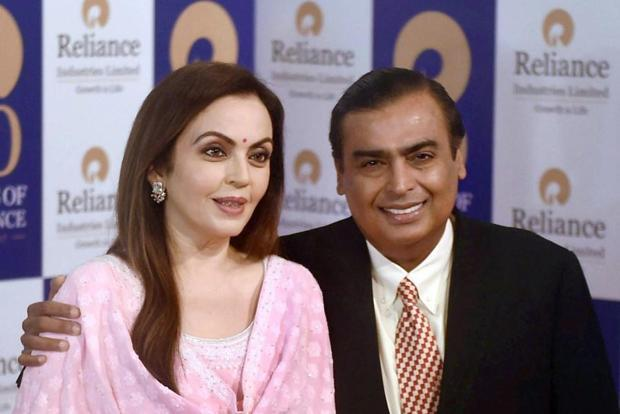 A file photo of Reliance Industries Ltd (RIL) chairman and India's wealthiest man Mukesh Ambani (right) and his wife Nita Ambani. Photo: PTI