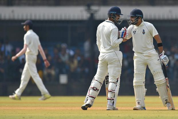 Delhi batsman Dhruv Shorey celebrates with his teammate Nitish Rana after completing his half-century in the 2nd innings on Monday. Photo: PTI