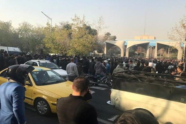 People protest near the University of Tehran, Iran, on Saturday in this picture obtained from social media. Photo: Reuters