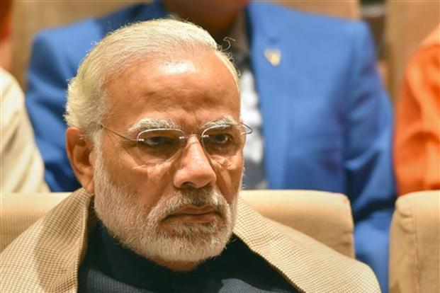 Narendra Modi said his government is deeply guided by Savitribai Phule's ideals 'and is working tirelessly towards fulfilling her vision.' Photo: PTI