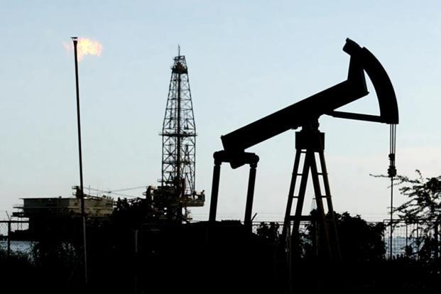 Oil prices will probably trade between $40 and $60 a barrel this year, penned in by rising US shale production, declining but still ample spare supplies and slipping discipline among Opec members, according to Moody's Investors Service. Photo: AP