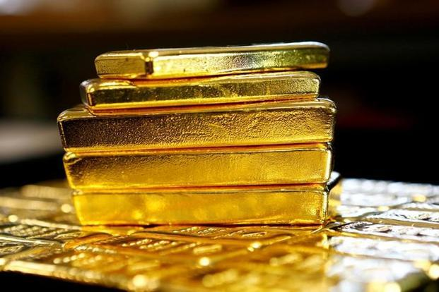Spot gold was mostly unchanged at $1,322.50 an ounce at 8.29am. Last week, the metal touched its highest since 15 September at $1,325.86. Photo: Reuters