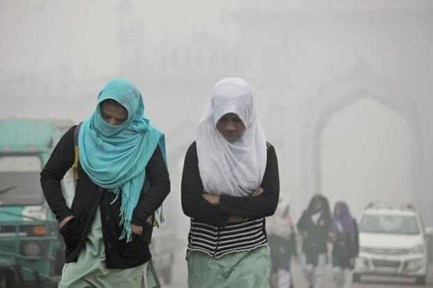 Children going to school amidst heavy fog on a cold morning in Lucknow on Tuesday. Photo: PTI