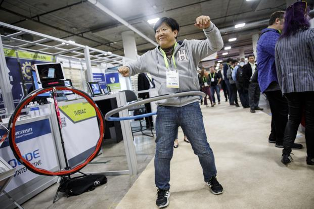 An attendee demonstrates smart fitness hoop during the 2018 Consumer Electronics Show (CES) in Las Vegas, Nevada, US, on Thursday. Photo: Bloomberg