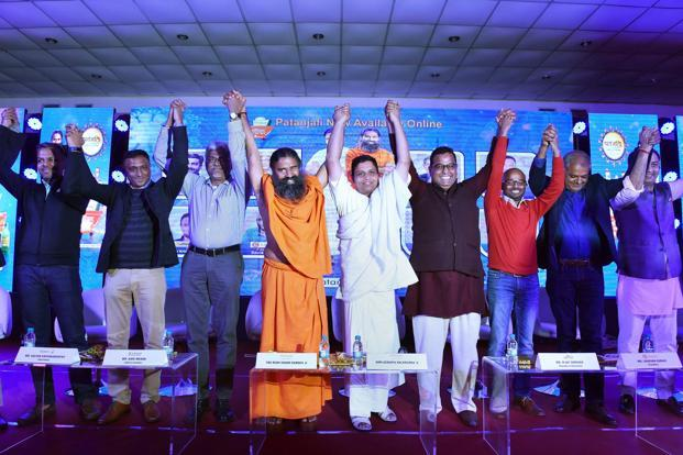 Baba Ramdev and Acharya Balkrishna at the announcement of availability of Patanjali products across major online portals, in New Delhi on Tuesday. Photo: PTI