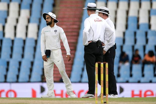 India skipper Virat Kohli with umpires during the second Test Match against South Africa in Centurion. Photo: AFP