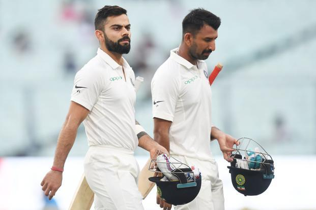 Virat Kohli, left, surprisingly pipped Australian skipper Steve Smith for the ICC's Test team captaincy. The ICC Test team also includes Cheteshwar Pujara  who scored 1,914 runs at 63.80 including seven centuries, nine half-centuries in 19 matches. Photo: AFP