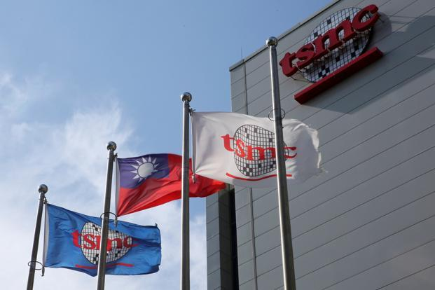Flags of Taiwan and Taiwan Semiconductor Manufacturing Co. (TSMC) are displayed next to its headquarters in Hsinchu. Photo: Reuters
